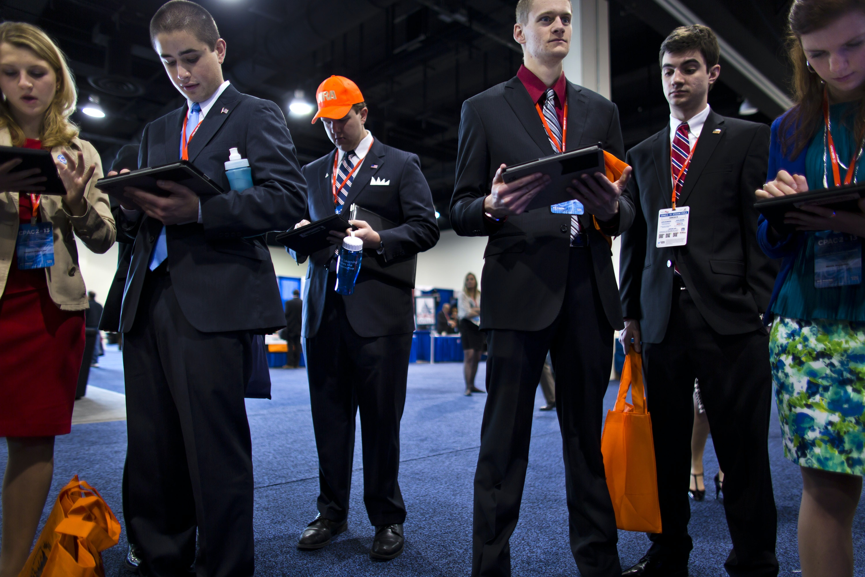 epa03625921 Young republicans holding iPads take a test, offered by the right-wing organization Generation Opportunity, about economic issues that are important to them at the 40th Annual Conservative Political Action Conference (CPAC) at the Gaylord National Resort & Convention Center in National Harbor, Maryland, USA, 15 March 2013.  EPA/JIM LO SCALZO
