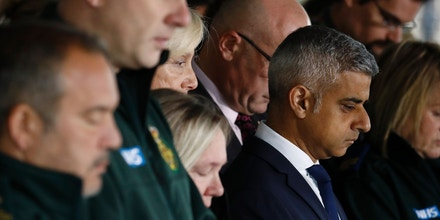 Mayor of London Sadiq Khan stands with ambulance paramedics as they pause for a minutes' silence in London on June 6, 2017, in memory of the victims of the June 3 terror attacks.Police on Monday identified two of the three London attackers as Khuram Butt and Rachid Redouane, after Britain's third terror assault in less than three months, as Prime Minister Theresa May came under mounting pressure over security just days ahead of elections. / AFP PHOTO / Odd ANDERSEN (Photo credit should read ODD ANDERSEN/AFP/Getty Images)