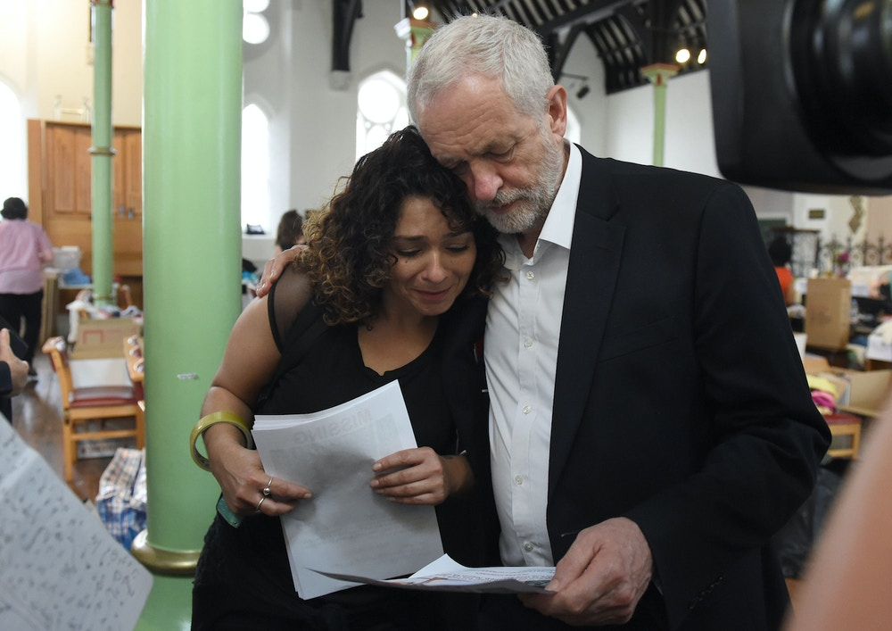 Tower block fire in London. Labour leader Jeremy Corbyn comforts a local resident (name not given) at St Clement's Church in west London where volunteers have provided shelter and support for people affected by the fire at Grenfell Tower. Picture date: Thursday June 15, 2017. Twelve people have died and more are feared dead after a huge fire destroyed the tower block in north Kensington. See PA story FIRE Grenfell. Photo credit should read: David Mirzoeff/PA Wire URN:31704411