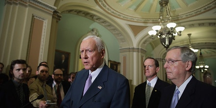 WASHINGTON, DC - JULY 30:  Sen. Orrin Hatch (R-UT) (C) is joined by Sen. Patrick Toomey (R-PA) and Senate Minority Leader Mitch McConnell (R-KY) while talking to reporters after the weekly Senate Republican Caucus policy luncheon July 30, 2013 in Washington, DC. McConnell joined Speaker of the House John Boehner (R-OH) in rejecting President Barack Obama's