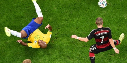 Germany's midfielder Bastian Schweinsteiger (R) controls the ball during the semi-final football match between Brazil and Germany at The Mineirao Stadium in Belo Horizonte during the 2014 FIFA World Cup on July 8, 2014. AFP PHOTO / POOL /  FRANCOIS XAVIER MARIT        (Photo credit should read FRANCOIS XAVIER MARIT/AFP/Getty Images)