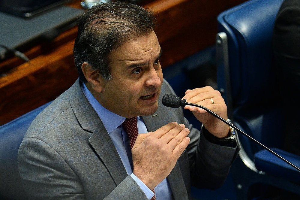 Senator Aecio Neves speaks during the third day of the Senate impeachment trial of Brazilian suspended President Dilma Rousseff at the National Congress in Brasilia on August 27, 2016.<br /><br /><br /><br /> Brazil's first woman president, Dilma Rousseff, faces the final act of an impeachment battle likely to see the suspended leader of Latin America's biggest economy sacked within days. / AFP / ANDRESSA ANHOLETE        (Photo credit should read ANDRESSA ANHOLETE/AFP/Getty Images)