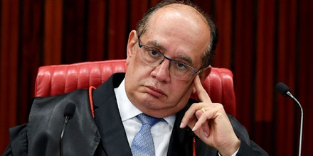 President of the Jury, Judge Gilmar Mendes, attends a meeting at the Supreme Electoral Court (TSE), on whether to invalidate the 2014 presidential election because of illegal campaign funding, in Brasilia, on April 4, 2017. Brazil's Supreme Electoral Court met Tuesday on whether to invalidate the 2014 presidential election because of illegal campaign funding -- a ruling that could in theory force out President Michel Temer. At issue are allegations that when then president Dilma Rousseff ran for re-election in 2014, with Temer as vice president, their ticket was financed by undeclared funds or bribes. Both Temer and Rousseff deny any wrongdoing. / AFP PHOTO / EVARISTO SA (Photo credit should read EVARISTO SA/AFP/Getty Images)