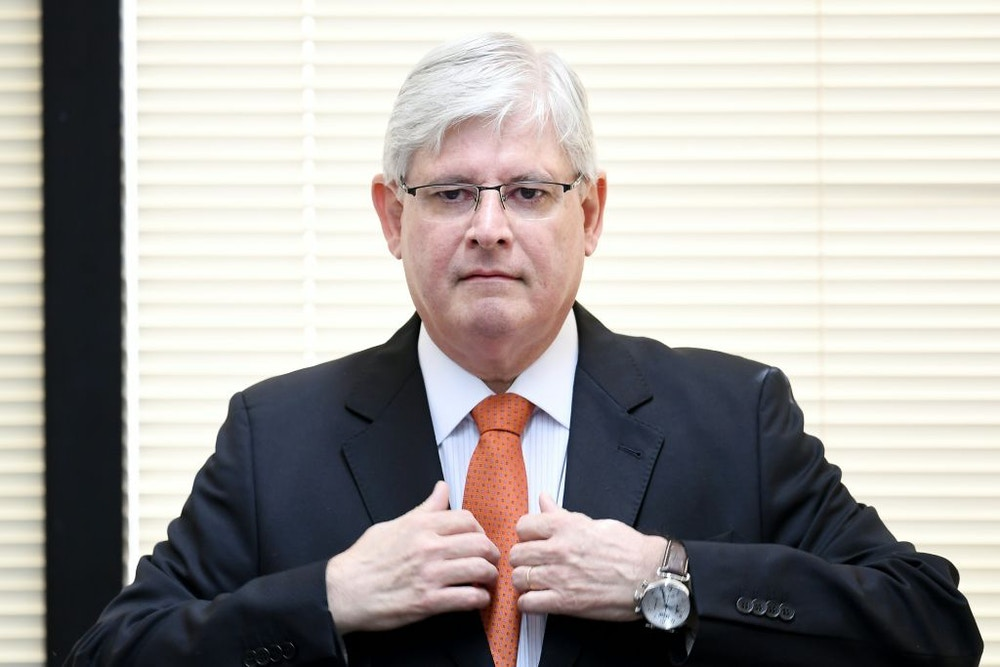 Brazil's Prosecutor General Rodrigo Janot takes part in the opening of the Brazil-Japan Seminar on Fighting Corruption, in Brasilia, on June 19, 2017. The opening of an investigation by Rodrigo Janot came close to bringing President Michel Temer down three weeks ago, but the conservative president has since dug in and defied Janot in dramatic fashion by ignoring a deadline to supply a written deposition. / AFP PHOTO / EVARISTO SA (Photo credit should read EVARISTO SA/AFP/Getty Images)