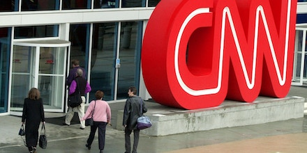 FILE- This Jan. 17, 2001 file photo shows pedestrians entering CNN Center, the headquarters for CNN,  in downtown Atlanta. The latest rough patch for CNN illustrates the two contradictions at the network's heart. In a brutal time for the news business, CNN is one of the few media organizations thriving while its most visible part in the United States, prime-time on the flagship network,  is hurting. The company has built its brand on nonpartisan reporting, while CNN's audience tilts Democratic as much or more as Fox News Channel's audience is Republican. (AP Photo/Ric Feld,File)