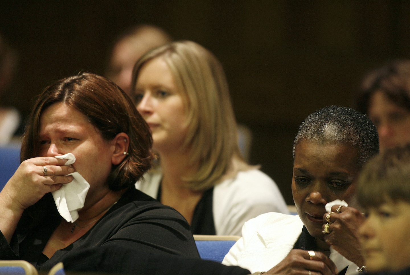 Cindy McFarland, widow of Montgomery Regional Security guard Derrick McFarland, left, and Rosalind McFarland, Derrick McFarland's mother, right, react after hearing Judge Ray Grubbs decision to move William Morva's capital murder trial to another venue Thursday, Sept. 20, 2007, at Montgomery County Circuit Court in Christiansburg, Va.  Grubbs moved the trial because of difficulty seating a jury. ?   Morva, 25, is accused in the August 2006 slayings of hospital security guard Derrick McFarland and county sheriff's Cpl. Eric Sutphin.  (AP Photo/Jared Soares, Pool)