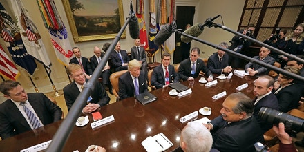 WASHINGTON, DC - JANUARY 23:  U.S. President Donald Trump (C) leads a meeting with invited business leaders and members of his staff in the Roosevelt Room at the White House January 23, 2017 in Washington, DC. Business leaders included Elon Musk of SpaceX, Wendell Weeks of Corning, Mark Sutton of International Paper, Andrew Liveris of Dow Chemical, Alex Gorsky of Johnston & Johnson and others.  (Photo by Chip Somodevilla/Getty Images)