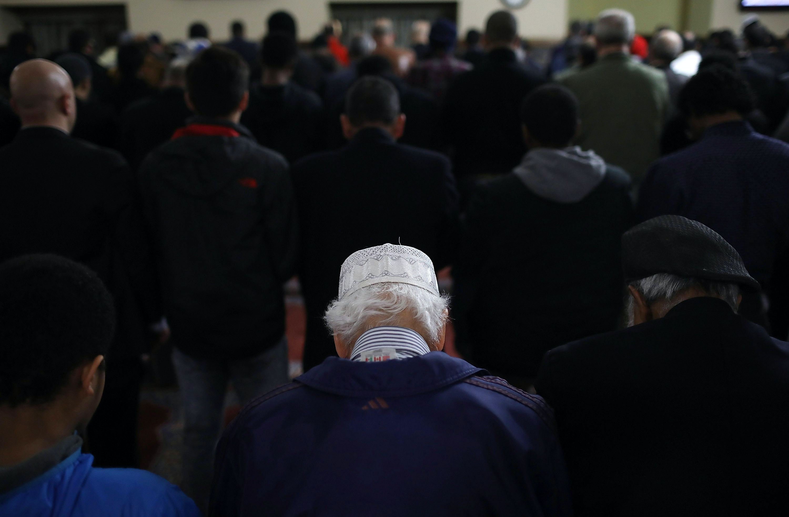 "FALLS CHURCH, VA - MARCH 17:  Members of the Dar Al-Hijrah Islamic Center mosque pray prior to a town hall meeting with Virginia Attorney General Mark Herring March 17, 2017 in Falls Church, Virginia. The town hall, sponsored by the Council on American-Islamic Relations, was held following U.S. President Donald Trump's executive order limiting immigration from 6 predominantly Muslim nations and also included a free free ""Citizenship Application Clinic.""  (Photo by Win McNamee/Getty Images)"