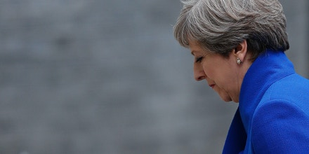 Britain's Prime Minister and leader of the Conservative Party Theresa May returns to 10 Downing Street in central London on June 9, 2017 after making a statement following the as results of a snap general election.A defiant Prime Minister Theresa May vowed Friday to form a new government to lead Britain out of the EU despite losing her majority in a snap general election and facing calls to resign. Although winning the most seats, May's centre-right Conservative party lost its majority in parliament, meaning it will now rely on support from Northern Ireland's Democratic Unionist Party (DUP). / AFP PHOTO / Adrian DENNIS (Photo credit should read ADRIAN DENNIS/AFP/Getty Images)