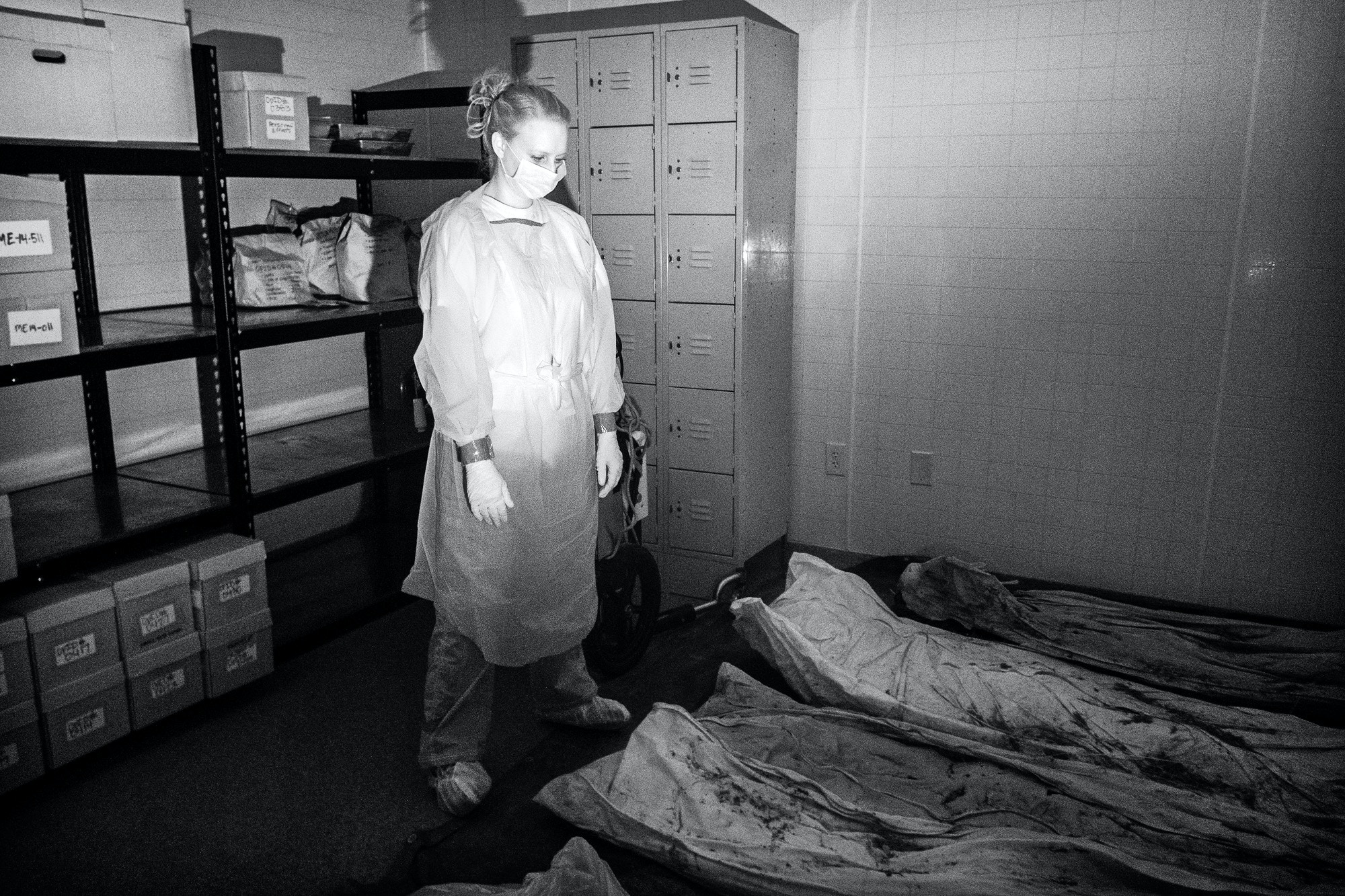 Graduate student Devora Gleiber examines unidentified victims' remains inside an evidence room at Texas State University in San Marcos, Texas, February 12, 2016. Texas State maintains custody of over 200 sets of human remains as part of Operation Identification (OpID), an intiative to identify and repatriate the remains of suspected migrants recovered along the U.S.-Mexico border.