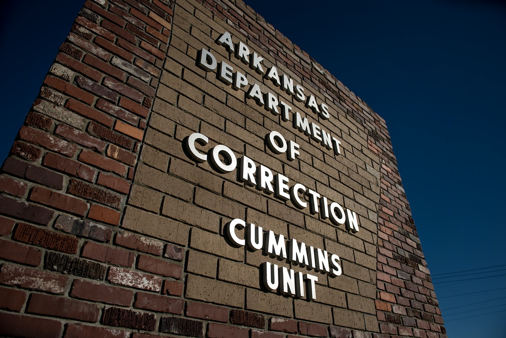 A sign marks the entrance to the Cummins Unit where the Arkansas death chamber is housed near Gould, Arkansas. In April four inmates were executed in eight days at the facility before a drug used in the lethal injection process expired. (Photo by Brandon Dill for The Intercept)