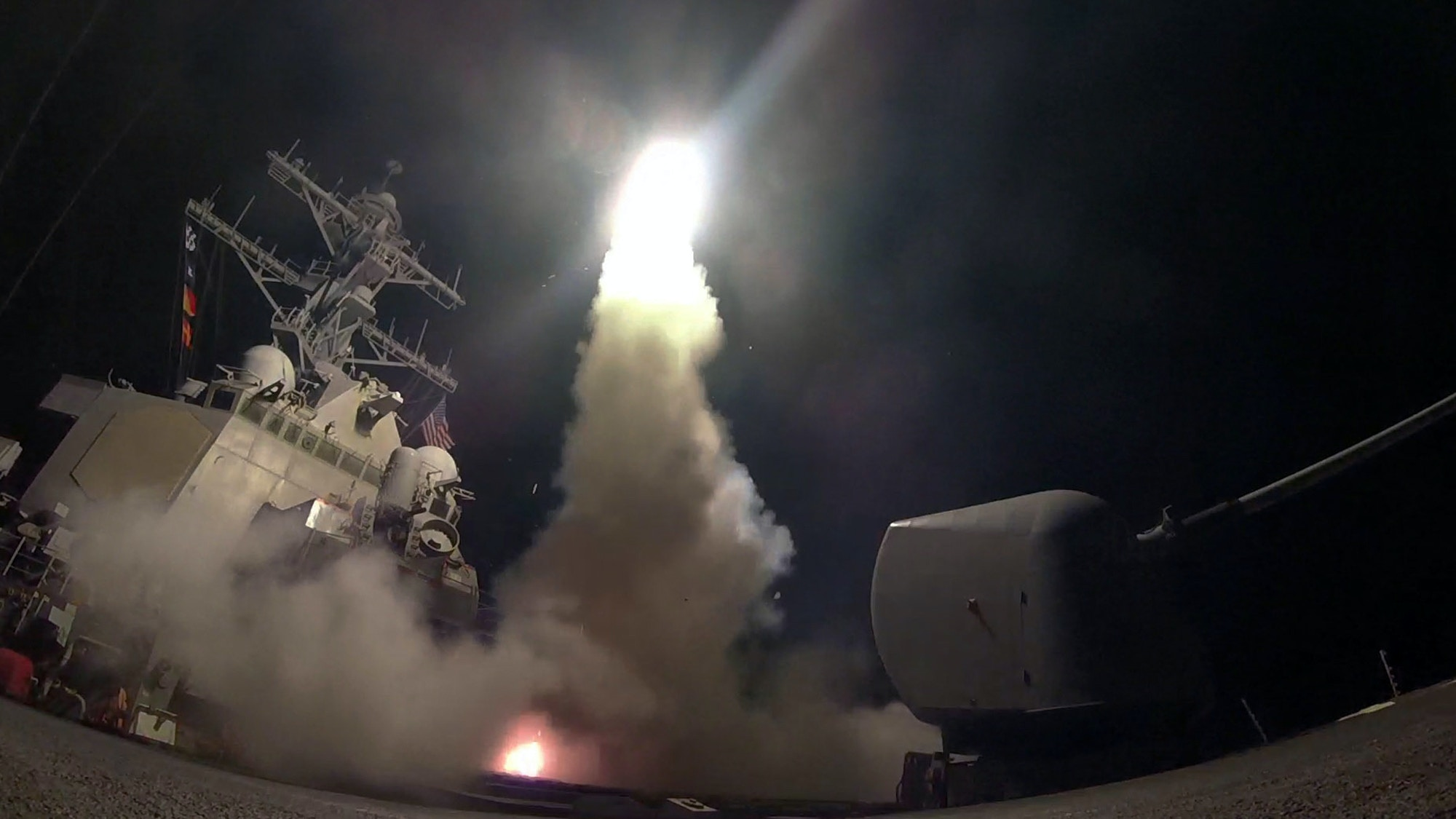 "FILE - In this Friday, April 7, 2017 file image provided by the U.S. Navy, the guided-missile destroyer USS Porter (DDG 78) launches a tomahawk land attack missile in the Mediterranean Sea as the United States blasted a Syrian air base with a barrage of cruise missiles in fiery retaliation for a gruesome chemical weapons attack against civilians earlier in the week. North Korea has vowed to bolster its defenses to protect itself against airstrikes like the ones President Donald Trump ordered against an air base in Syria. The North called the airstrikes ""absolutely unpardonable"" and said it proves that its nuclear weapons are justified to protect the country against Washington's ""evermore reckless moves for a war."" (Mass Communication Specialist 3rd Class Ford Williams/U.S. Navy via AP, File)"