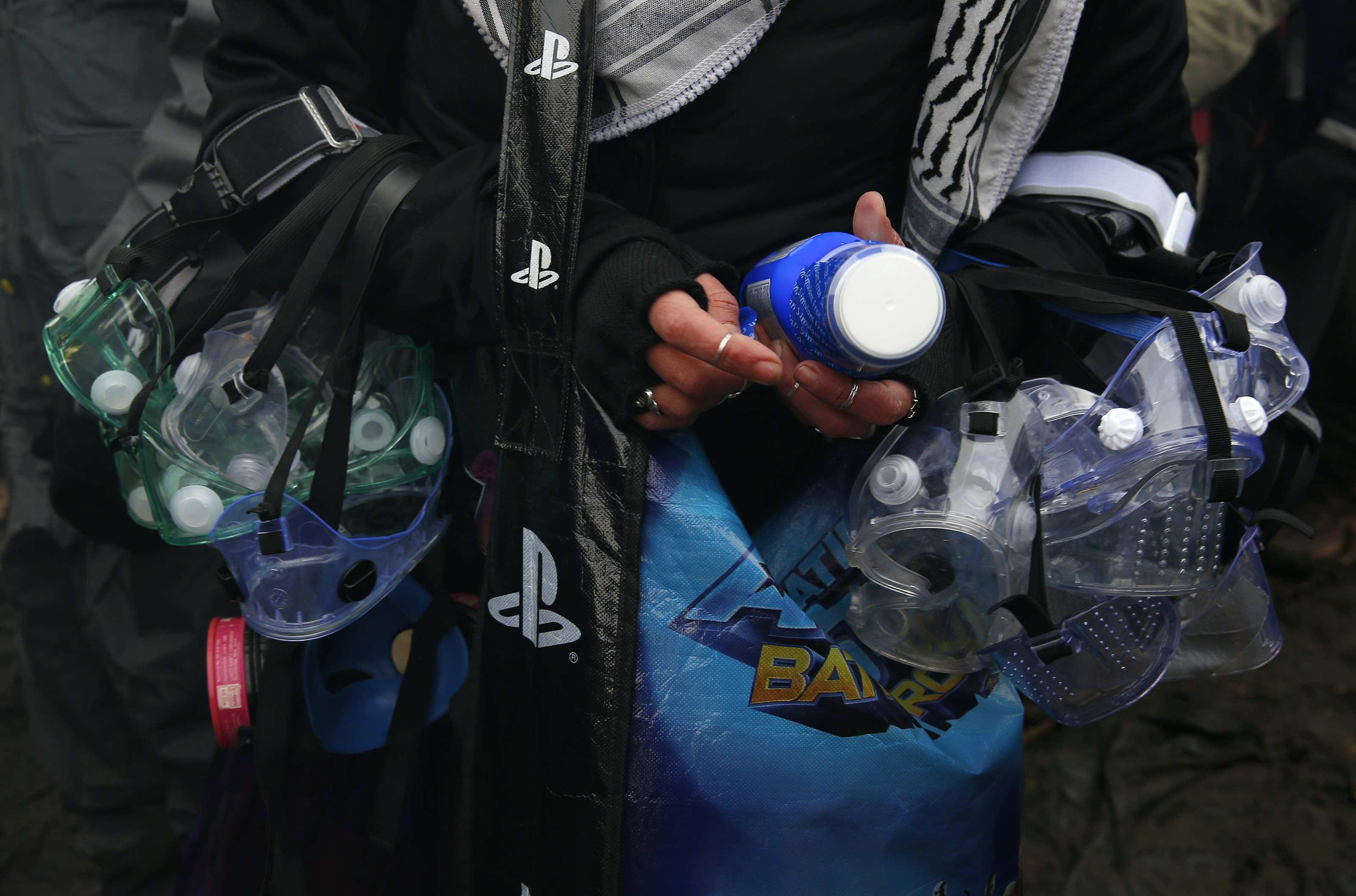 CANNON BALL, ND - NOVEMBER 24: A water protector loads up on goggles and milk of magnesia in anticipation of a confrontation with police as she prepares to cross the bridge to Turtle Island at Standing Rock on Nov. 24, 2016, during an ongoing dispute over the building of the Dakota Access Pipeline. (Photo by Jessica Rinaldi/The Boston Globe via Getty Images)