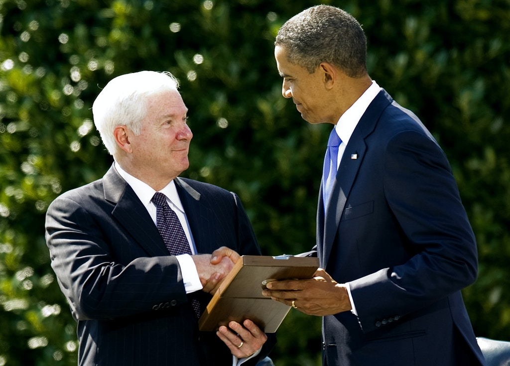 US President Barack Obama (R) presents the Presidential Medal of Freedom to outgoing Secretary of Defense Robert Gates during the Armed Forces Farewell Tribute for Gates at the Pentagon's River Terrace Parade Field in Washington, DC, June 30, 2011.   AFP PHOTO/Jim WATSON (Photo credit should read JIM WATSON/AFP/Getty Images)