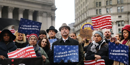 NEW YORK, NY - JANUARY 27:  Area Muslims and local immigration activists participate in a prayer and rally against President Donald Trump's immigration policies on January 27, 2017 in New York City. President Trump has taken actions since the inauguration to start the building of a long promised wall along the Mexican border and to cut federal grants for immigrant protecting 'sanctuary cities'.  (Photo by Spencer Platt/Getty Images)