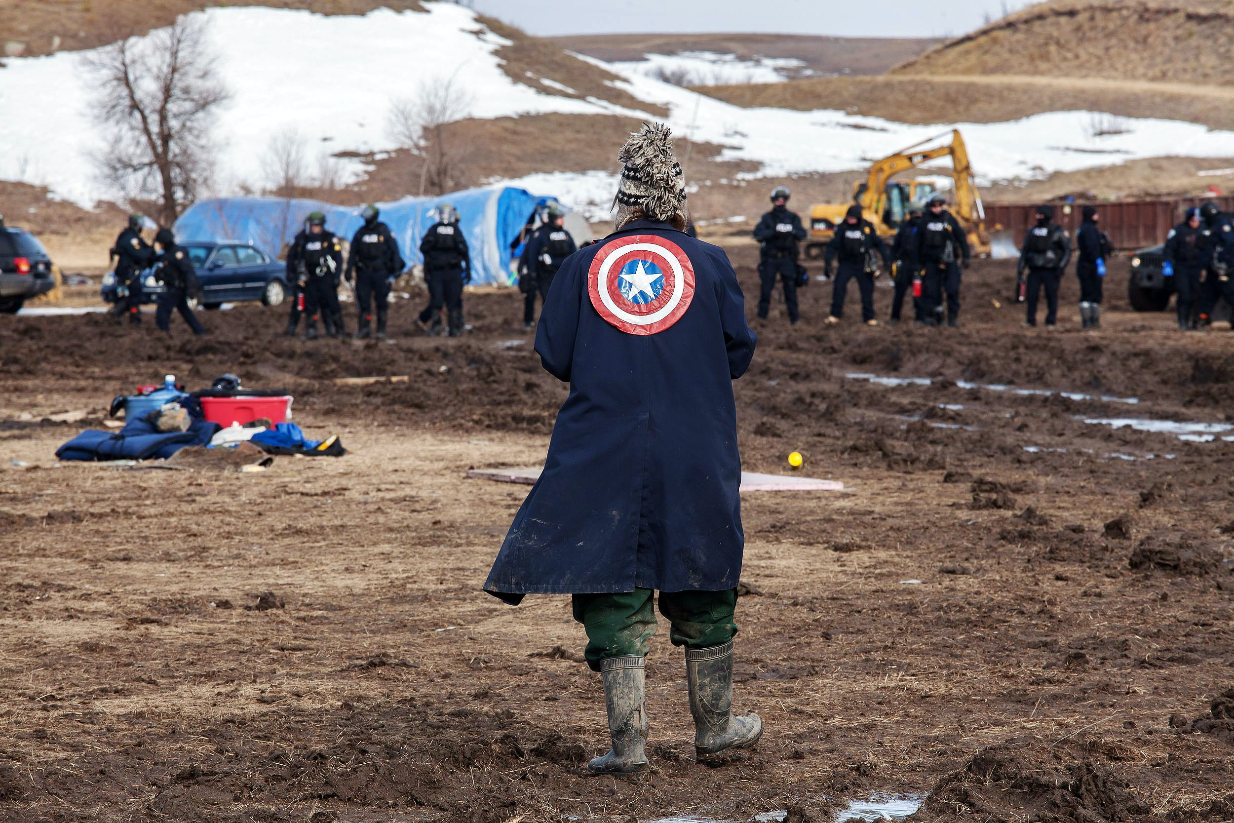 A Protester make their last stand as authorites approach Oceti Sakowin Encampment in North Dakota Authorities clear Standing Rock protest camp, North Dakota, USA - 23 Feb 2017 (Rex Features via AP Images)