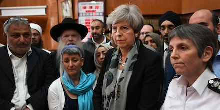 LONDON, ENGLAND - JUNE 19: British Prime Minister Theresa May and Metropolitan Police Commissioner Cressida Dick talk to faith leaders at Finsbury Park Mosque on June 19, 2017 in London, England.  Worshippers were struck by a hired van as they were leaving Finsbury Park mosque in North London after Ramadan prayers. One person was killed in the terror attack with a further 10 people injured.  (Photo by Stefan Rousseau/WPA Pool/Getty Images)
