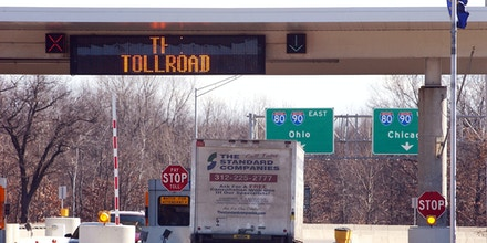 **FILE** A truck enters the Indiana Toll Road at the Portage, Ind. entrace in northwest Indiana Wednesday, in a Jan. 25, 2006 file photo. Gov. Mitch Daniels Daniels put the Indiana Toll Road out for bid, collecting $3.8 billion upfront for a 75-year lease. Daniels is leading the way among cash-strapped governors who are contracting out services states historically have handled themselves. (AP Photo/Joe Raymond, File)