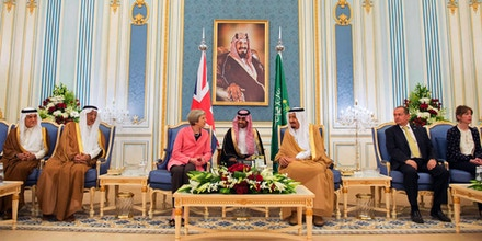 In this photo released by the Saudi Press Agency, SPA, Saudi King Salman, center right, receives British Prime Minister Theresa May, in Riyadh, Saudi Arabia, Wednesday, April 5, 2017. May pitched the benefits of the London Stock Exchange on Wednesday during the second day of her two-day visit to Saudi Arabia as it weighs which international market to list shares of oil giant Aramco in what many expect will be the largest public offering in history. (Saudi Press Agency via AP)