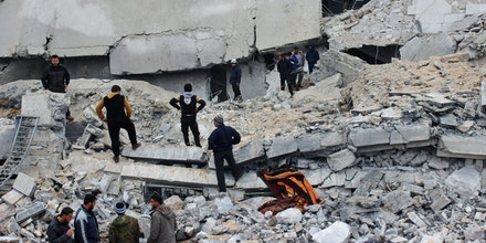 ALEPPO, SYRIA -  MARCH 17 : Civil defense team members and people try to rescue people who were trapped under the debris of a Mosque after warcrafts belonging to USA airforces carried out airstrikes during night prayer in Al-Jineh village of Atarib district in Aleppo, Syria on March 17, 2017. (Photo by brahim Ebu Leys/Anadolu Agency/Getty Images)