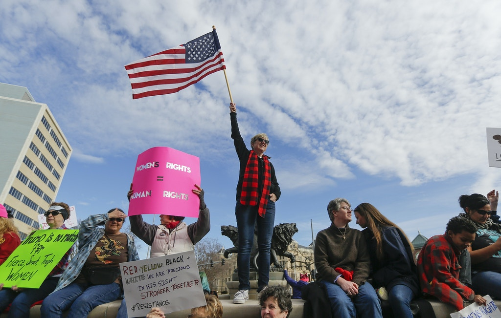 Several thousand people turned out at the Keeper of the Plains on Saturday, Jan. 21, 2017, to take part in the Women's March in Wichita, Kan. Similar events were held across the globe, with an estimated 500,000 turning out in Washington, DC. (Travis Heying/The Wichita Eagle via AP)