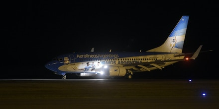 Aerolineas Argentinas' aircraft ploted with the portraits of forward Lionel Messi, goalkeeper Sergio Romero and forward Gonzalo Higuain is seen after landing at Tancredo Neves International Airport in Confins near Belo Horizonte, some 480 Km north of Rio de Janeiro, Brazil on June 9, 2014. Argentina team arrive in Brazil ahead of the 2014 FIFA World Cup. AFP PHOTO / Juan Mabromata        (Photo credit should read JUAN MABROMATA/AFP/Getty Images)