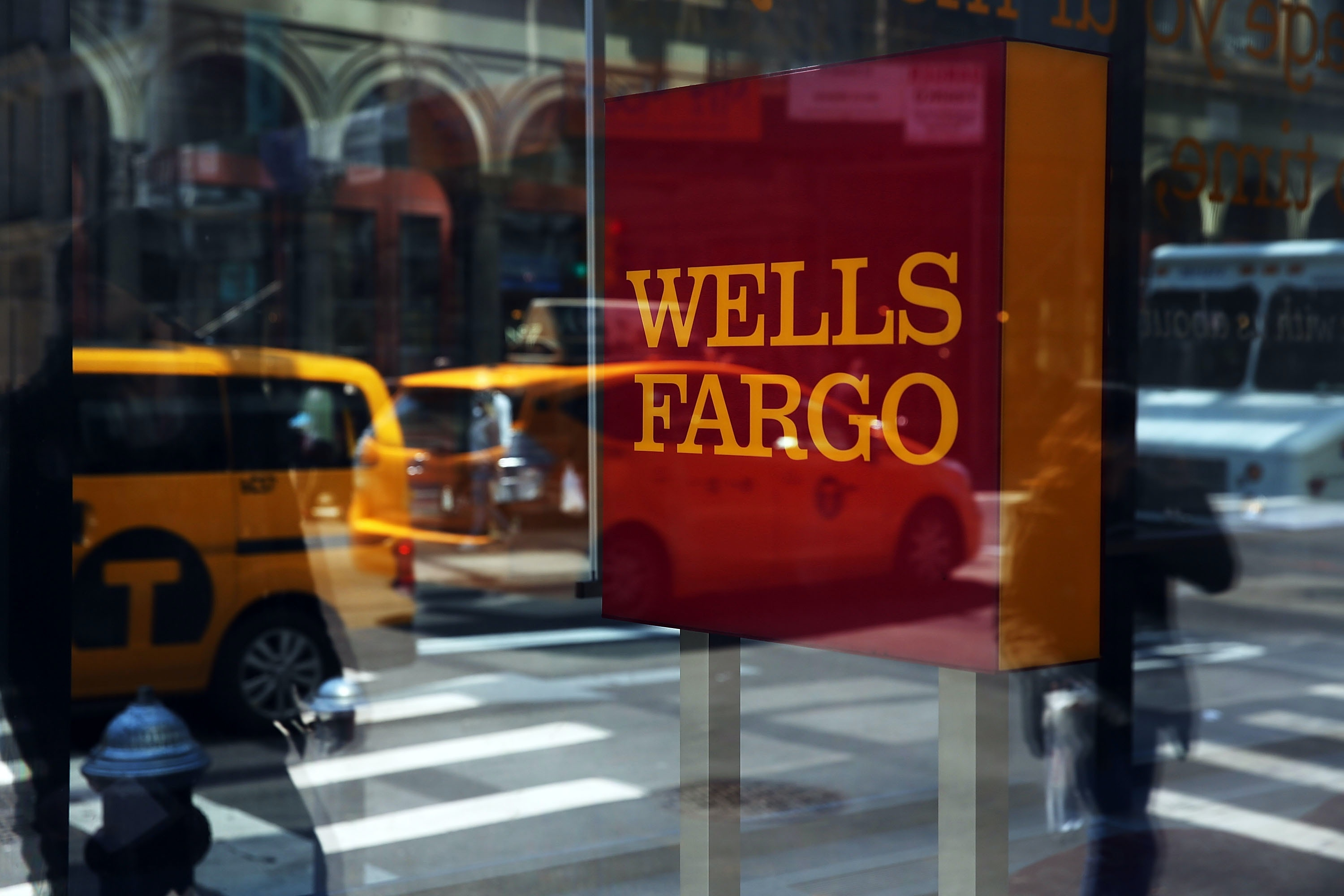 NEW YORK, NY - APRIL 15:  Pedestrians pass a Wells Fargo bank branch in lower Manhattan on April 15, 2016 in New York City. As global markets continue to be rattled by the fall in energy prices and the easing of the Chinese economy, JPMorgan Chase, Bank of America and Wells Fargo announced on Thursday that their profits fell in the first quarter. At JPMorgan revenue fell 13 percent from a year earlier.  (Photo by Spencer Platt/Getty Images)