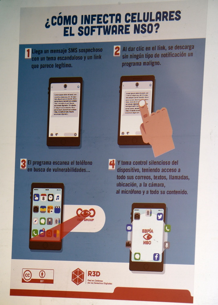 "The explanation on how an espionage tool infects mobile phones is seen during a journalists' press conference in Mexico City on June 19, 2017, on an article published by the New York Times: ""Using Texts as Lures, Government Spyware Targets Mexican Journalists and Their Families"". / AFP PHOTO / ALFREDO ESTRELLA        (Photo credit should read ALFREDO ESTRELLA/AFP/Getty Images)"