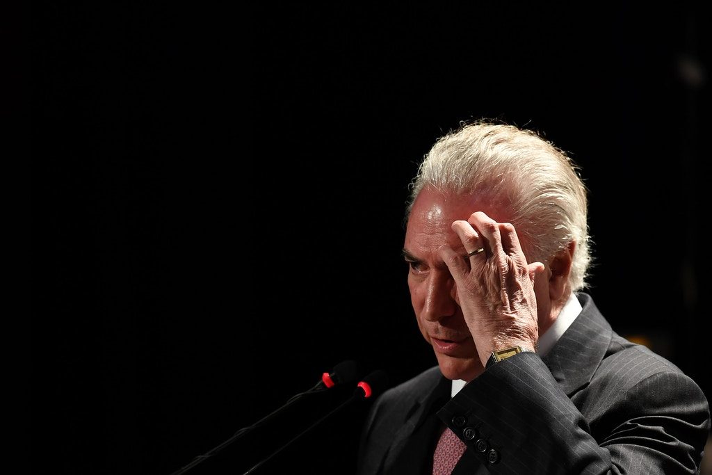 Brazilian President Michel Temer speaks during the ceremony for the launching of the Agricultural and Livestock Plan 2017/2018 in Brasilia,  on July 11, 2017. / AFP PHOTO / EVARISTO SA        (Photo credit should read EVARISTO SA/AFP/Getty Images)