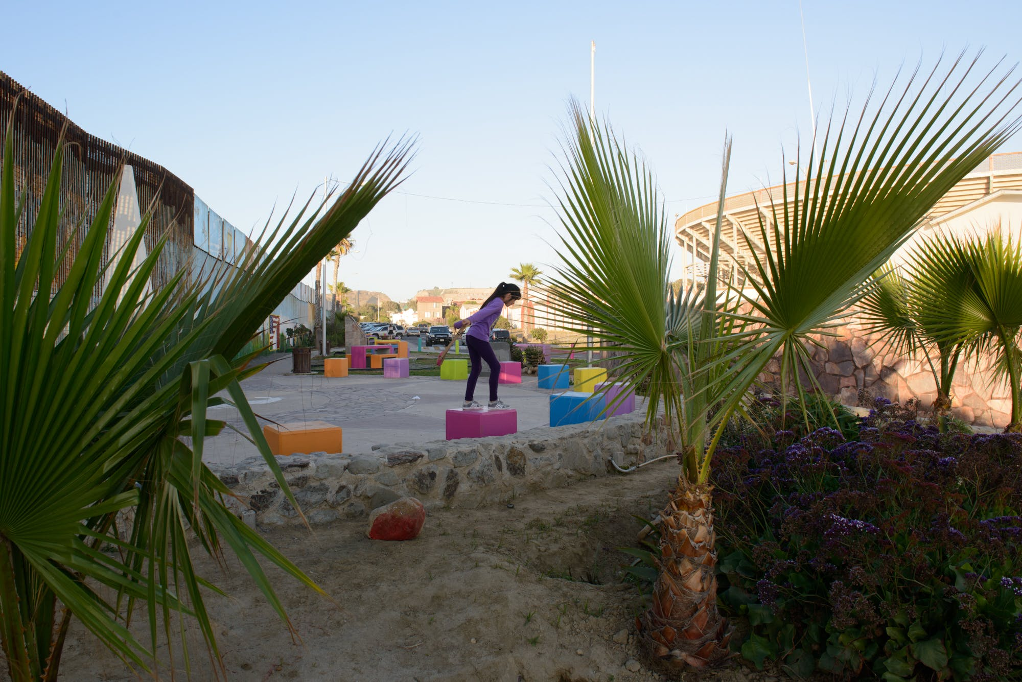 A child plays near the wall marking the border between the U.S. and Mexico in Playas de Tijuana.