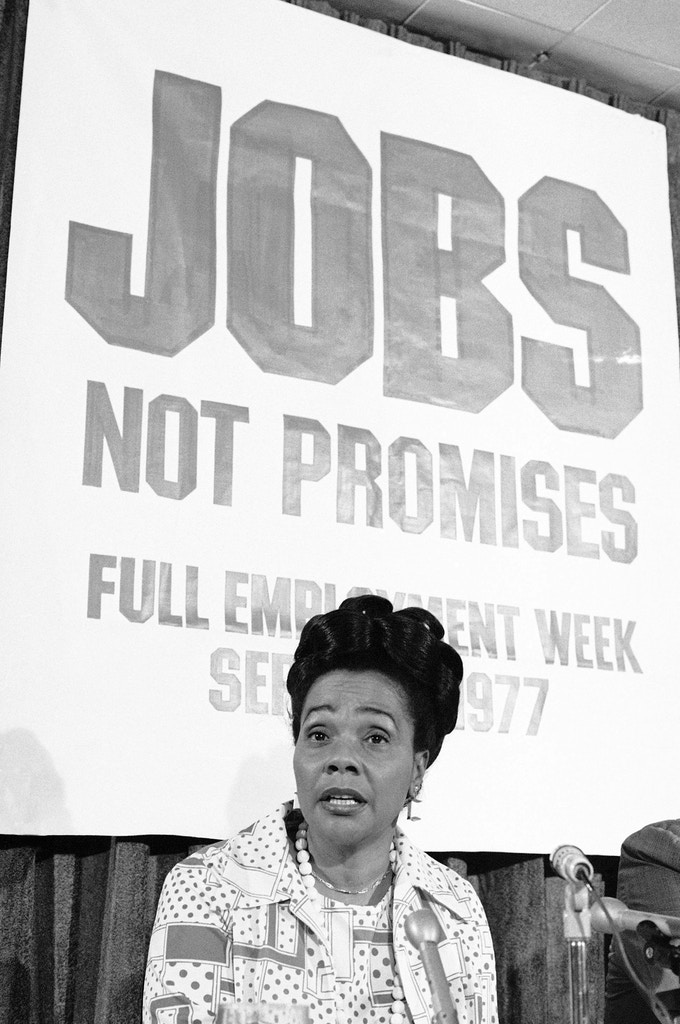 Mrs. Coretta Scott King, widow of Dr. Martin Luther King Jr., talks to reporters at a press conference in Washington  Thursday, August 18, 1977. Mrs. King, President of the Martin Luther King Center for Social Change, briefed reporters on demonstrations for jobs planned for 50 cities during Labor Day week. (AP Photo/Henry Griffin)