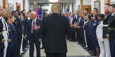 US President Donald Trump greets members of the US military alongside Vice President Mike Pence (L) following a meeting at the Pentagon in Washington, DC, July 20, 2017. / AFP PHOTO / SAUL LOEB        (Photo credit should read SAUL LOEB/AFP/Getty Images)