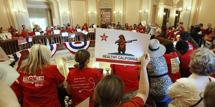 Members of the California Nurses Association and supporters rally on the second floor rotunda at the Capitol calling for a single-payer health plan, Wednesday, June 28, 2017, in Sacramento, Calif. The demonstrators were demanding that Assembly Speaker Anthony Rendon, D-Paramount, bring a health care bill, SB562, by state Senators Ricardo Lara, D-Bell Garden, and Toni Atkins, D-San Diego, to a vote in the Assembly. (AP Photo/Rich Pedroncelli)