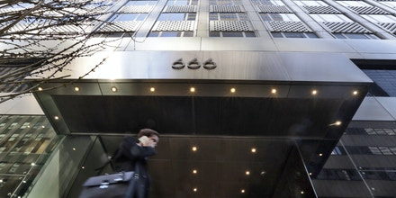 A businessman walks by the 666 Fifth Avenue skyscraper owned by Kushner Cos., Wednesday, March 29, 2017, in New York. The Kushner Cos. confirmed Wednesday that negotiations with Anbang Insurance Group to help fund redevelopment of the family's office tower on Manhattan's Fifth Avenue have ended. (AP Photo/Richard Drew)