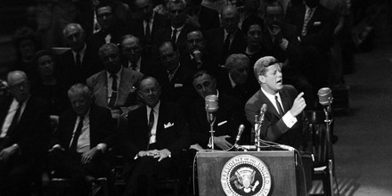 President John F. Kennedy gestures during his speech before a rally on medical care for the aged at New York's Madison Square Garden, May 20, 1962. The president said  there was nothing new about arguments against the Medicare program - they were the same ones raised 25 years ago when Social Security was proposed. (AP Photo)