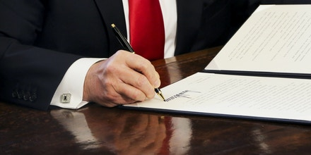 WASHINGTON, DC - FEBRUARY 3: U.S. President Donald Trump signs Executive Orders in the Oval Office of the White House, including an order to review the Dodd-Frank Wall Street to roll back financial regulations of the Obama era February 3, 2017 in Washington, DC. (Photo by Aude Guerrucci - Pool/Getty Images)