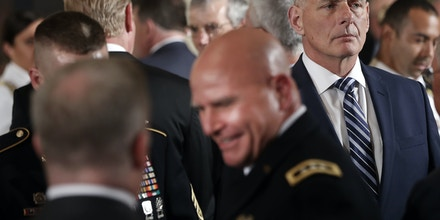 White House Chief of Staff John Kelly, right, looks across the room at event where President Donald Trump was to bestow the Medal of Honor to retired Army medic James McCloughan during a ceremony in the East Room of the White House in Washington, Monday, July 31, 2017. Also in the room is outgoing White House press secretary Sean Spicer, left and national security adviser H.R. McMaster, center. (AP Photo/Pablo Martinez Monsivais)