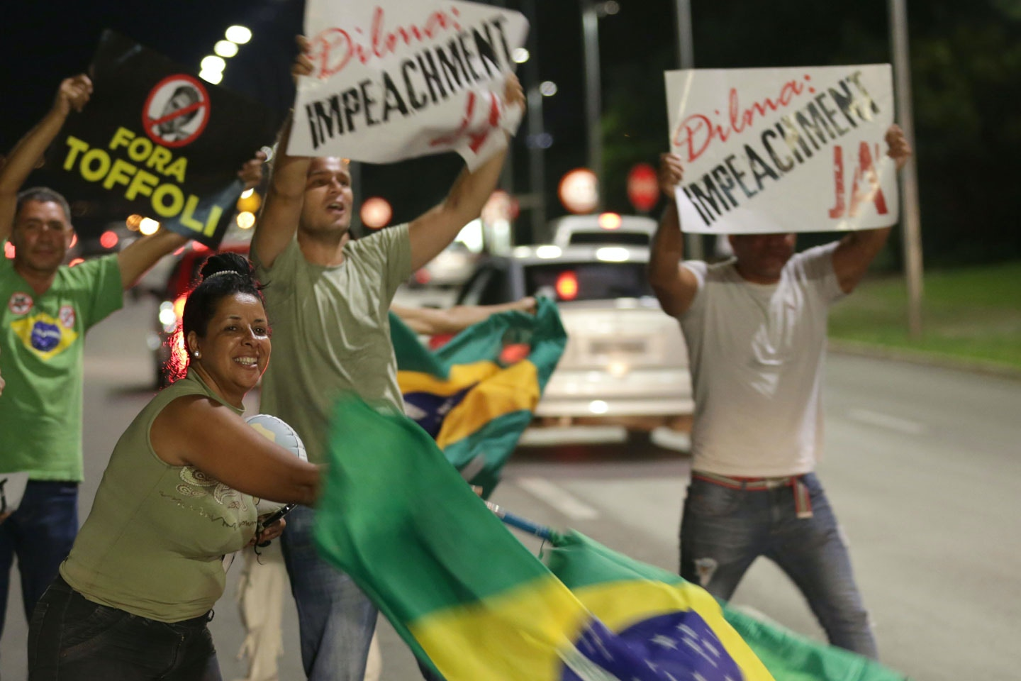 FILE - In this Dec. 2, 2015 file photo, people demonstrate against the government as they take part in protest in favor of impeaching Brazil's President Dilma Rousseff, in front of the National Congress, in Brasilia, Brazil. The country has seen a vicious circle of ballooning crises over the past year. Major scandals, some of which are connected to Rousseff, have combined with tanking commodity prices to deliver blows to the powerhouse economy, including credit-rating downgrades, a sharp currency devaluation and 10-percent annual inflation. (AP Photo/Eraldo Peres, File)