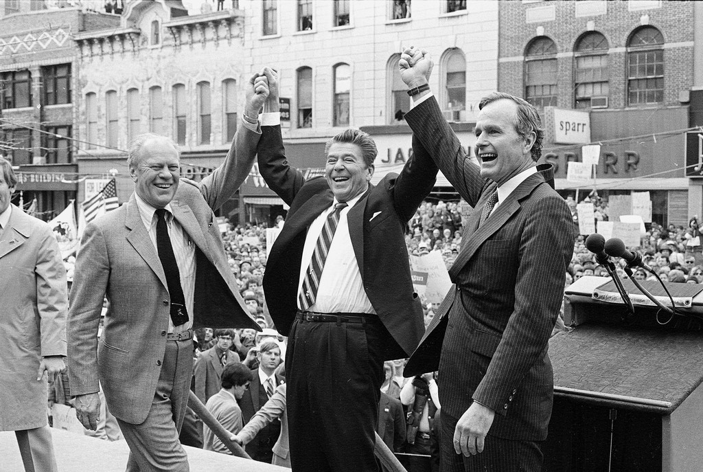 Former president Gerald Ford, left, lends his support to fellow Republican and presidential candidate Ronald Reagan and running mate George Bush, seen here on the final day of campaining in Peoria, Ill., on November 3, 1980.  (AP Photo)