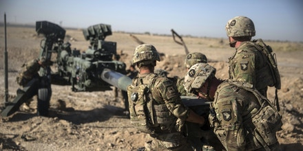This June 10, 2017 photo provided by Operation Resolute Support, U.S. Soldiers with Task Force Iron maneuver an M-777 howitzer, so it can be towed into position at Bost Airfield, Afghanistan. Sixteen years into its longest war, the United States is sending another 4,000 troops to Afghanistan in an attempt to turn around a conflict characterized by some of the worst violence since the Taliban were ousted in 2001. They are also facing the emergence of an Islamic State group affiliate and an emboldened Taliban, who by Washington's own watchdog's assessment now control nearly half of Afghanistan. (U.S. Marine Corps photo by Sgt. Justin T. Updegraff, Operation Resolute Support via AP)
