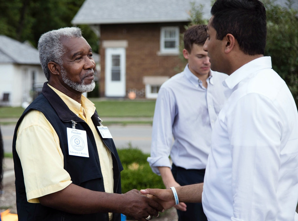 Ameya Pawar shaking hands with Ed Butler from the Three Kings of Peace following a peace march in Danville, Ill. on July 22, 2017.