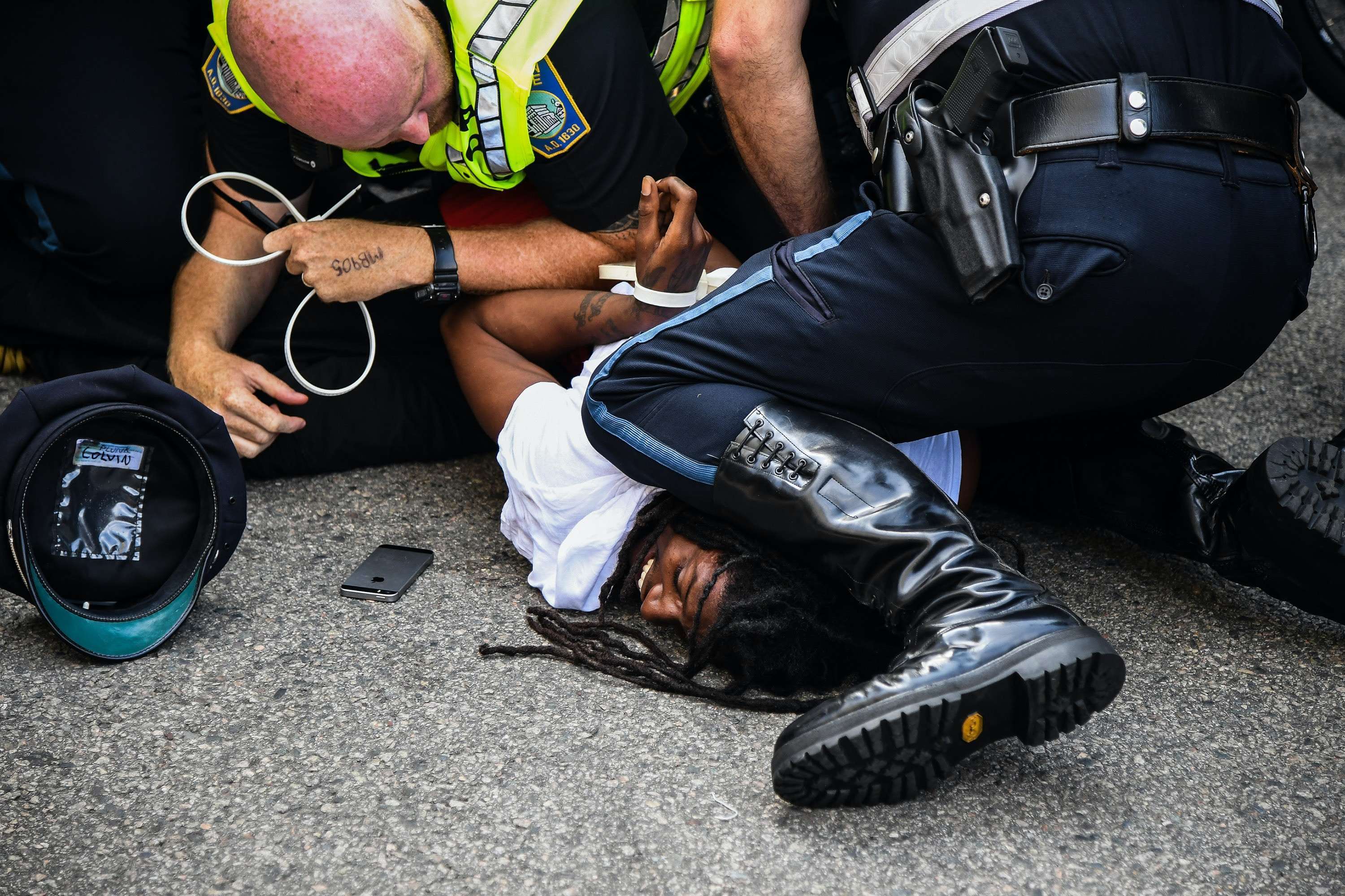 BOSTON, MA - AUGUST 19: A man gets arrested by police as hundreds of counter protesters try to block Free Speech protesters from leaving the Boston Common after the rally on Saturday, August 19, 2017, in Boston, MA. (Photo by Salwan Georges/The Washington Post via Getty Images)