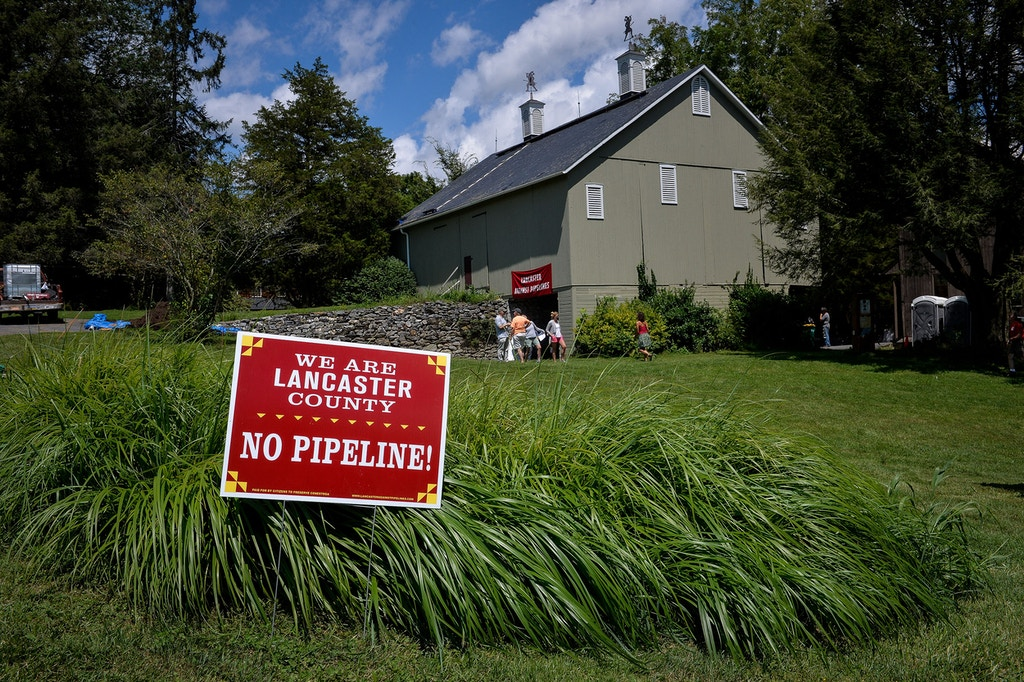 A sign condemning the proposed Atlantic Sunrise pipeline at a farm next to one of William's planned water-extraction sites on the Conestoga River, in Millersville, Pennsylvania, August 5, 2017.