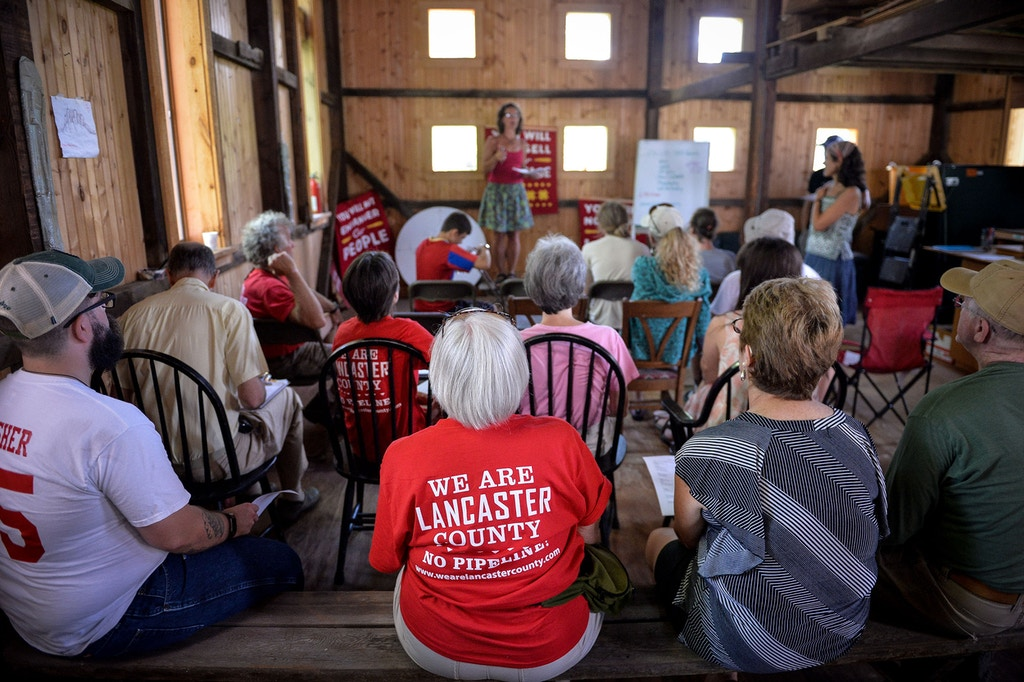 Lancaster Against Pipelines activists gather for a planning session at a farm next to one of William's planned water-extraction sites on the Conestoga River, in Millersville, Pennsylvania, August 5, 2017.