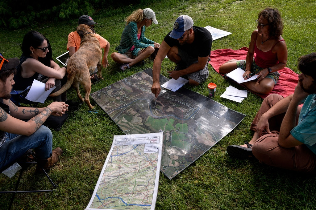 Lancaster Against Pipelines activists look at maps showing the path of the proposed Atlantic Sunrise pipeline during a strategy planning session at a farm next to one of William's planned water-extraction sites on the Conestoga River, in Millersville, Pennsylvania, August 5, 2017.