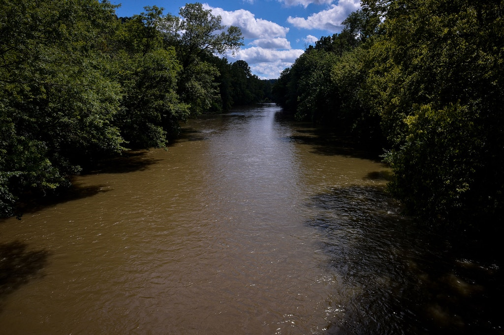 The Conestoga River flows languidly near where Williams plans to extract water during the construction of the Atlantic Sunrise pipeline in Millersville, Pennsylvania, August 5, 2017.