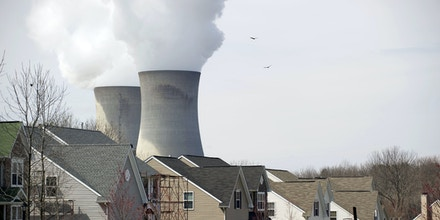 Cooling towers from the Limerick Generating Station, a nuclear power plant in Pottstown, Pennsylvania, are seen from a nearby neighborhood March 25, 2011. Limerick consists of two boiling water reactors designed by General Electric and is located on the Schuylkill River. AFP PHOTO/Stan HONDA / AFP PHOTO / STAN HONDA        (Photo credit should read STAN HONDA/AFP/Getty Images)