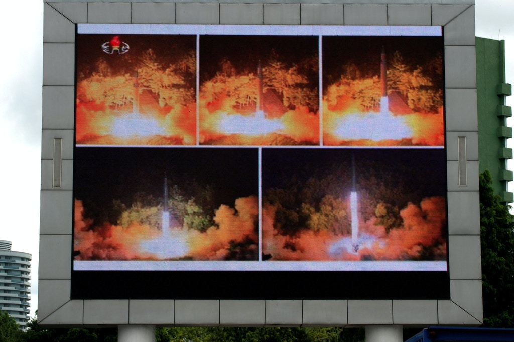 Coverage of an ICBM missile test is displayed on a screen in a public square in Pyongyang on July 29, 2017.Kim Jong-Un boasted of North Korea's ability to strike any target in the US after a second ICBM test that weapons experts said on July 29 could even bring New York into range - in a potent challenge to President Donald Trump. / AFP PHOTO / Kim Won-Jin (Photo credit should read KIM WON-JIN/AFP/Getty Images)