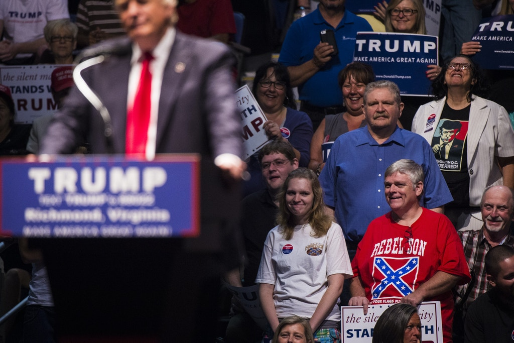 RICHMOND, VA - JUNE 10: A man wears a shirt with a confederate flag on it as Republican Presidential candidate Donald Trump speaks during a rally at the Richmond Coliseum in Richmond, VA on Friday June 10, 2016. (Photo by Jabin Botsford/The Washington Post via Getty Images)