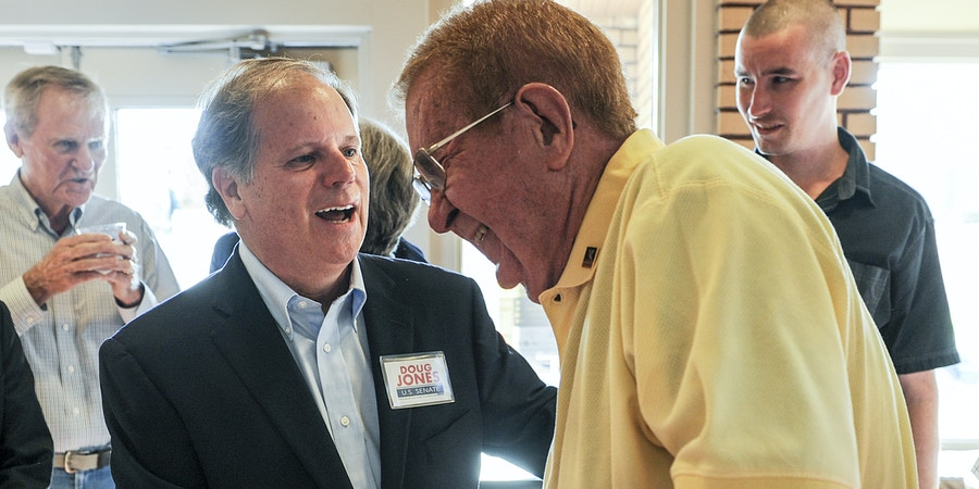 Candidate Doug Jones, left, jokes with former Alabama state Sen. Ray Campbell before a Democratic Senate candidate forum at the Princess Theatre in Decatur, Ala. Thursday, Aug. 3, 2017. (Jeronimo Nisa /The Decatur Daily via AP)